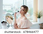 young woman is applying  makeup ... | Shutterstock . vector #678466477