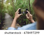 woman use phone taking nature...   Shutterstock . vector #678497299
