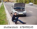 a young man sitting on the road ... | Shutterstock . vector #678498145