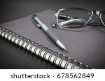 notebook glasses and pen on... | Shutterstock . vector #678562849