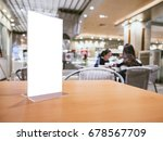 mock up menu frame on table bar ... | Shutterstock . vector #678567709