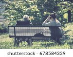 back view of old woman with...   Shutterstock . vector #678584329