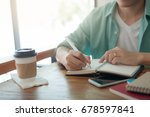asian freelancer with casual... | Shutterstock . vector #678597841