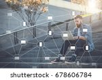 young businessman sits outdoor...   Shutterstock . vector #678606784