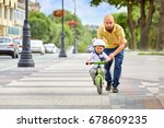 first lessons bicycle riding....   Shutterstock . vector #678609235