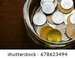 coins in a jar for saving... | Shutterstock . vector #678623494