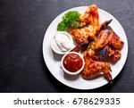 plate of grilled chicken wings... | Shutterstock . vector #678629335