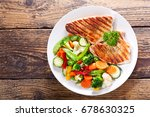 plate of grilled chicken with... | Shutterstock . vector #678630325