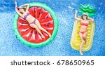 happy girls floating with... | Shutterstock . vector #678650965