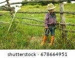 a little boy cowboy on nature | Shutterstock . vector #678664951