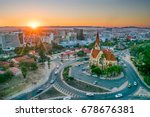 namibia's capital at sunset  | Shutterstock . vector #678676381
