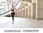 confident fit girl jogging... | Shutterstock . vector #678682909