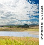 cloudy landscape with river - stock photo