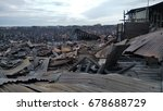 Small photo of Tawau, Malaysia - July 01, 2017: Squatters living on makeshift houses on stilts at sea at Kampung Hidayat, Batu 4, had their homes destroyed in a blaze.
