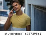young man looking away while... | Shutterstock . vector #678739561
