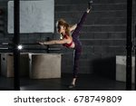 cute young woman stretching and ... | Shutterstock . vector #678749809