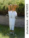 closed white umbrellas in the... | Shutterstock . vector #678753055