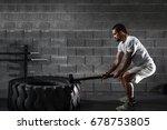 sport fitness man hitting wheel ... | Shutterstock . vector #678753805