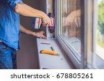 man in a blue shirt does window ... | Shutterstock . vector #678805261