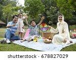 malay family having fun at the... | Shutterstock . vector #678827029
