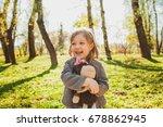 little girl embracing plush toy ... | Shutterstock . vector #678862945