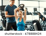 trainer helping athletic woman... | Shutterstock . vector #678888424