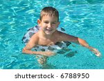 Cheerful boy in a swimming pool - stock photo
