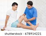 therapist treating injured knee ... | Shutterstock . vector #678914221