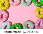colorful glazed donuts on a... | Shutterstock . vector #678916741
