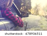 dreaming woman relaxes by car... | Shutterstock . vector #678936511