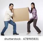 couple carrying a brown box | Shutterstock . vector #678985831