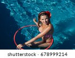 woman playing with hula hoop in ... | Shutterstock . vector #678999214