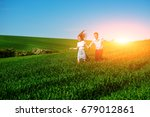young happy lovers running on... | Shutterstock . vector #679012861