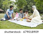 malay family having fun at the... | Shutterstock . vector #679018909