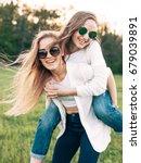 two young women are having fun... | Shutterstock . vector #679039891
