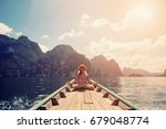 young female sitting on the... | Shutterstock . vector #679048774