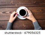 overhead shot of woman's hands... | Shutterstock . vector #679056325