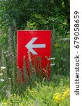 Small photo of Red direction sign