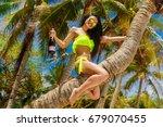 young beautiful girl in bikini... | Shutterstock . vector #679070455