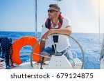 young man sailing yacht... | Shutterstock . vector #679124875