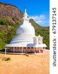 Small photo of Japanese Peace Stupa or Peace Pagoda at the foot of Adams Peak. Adams Peak or Sri Pada is a tall and holy mountain in Sri Lanka.
