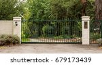 green metal driveway entrance... | Shutterstock . vector #679173439