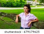 beautiful young woman outdoor... | Shutterstock . vector #679179625