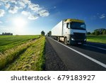 trucks driving on asphalt road... | Shutterstock . vector #679183927