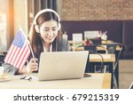 young american woman using... | Shutterstock . vector #679215319