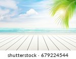 empty wooden table and palm... | Shutterstock . vector #679224544
