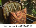 old chair with old pillow... | Shutterstock . vector #679241911