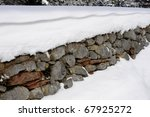 Wall Of Stones Covered With Snow