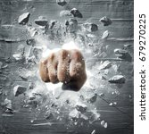 fist punching out from wall... | Shutterstock . vector #679270225