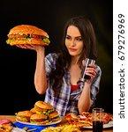 woman eating hamburger. student ... | Shutterstock . vector #679276969